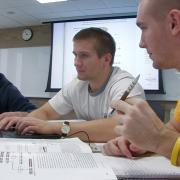 University of Iowa students engaging in a classroom discussion.
