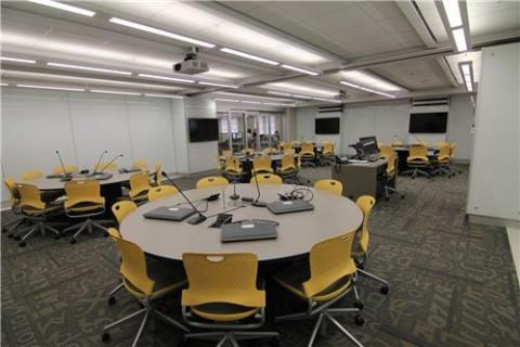 1140 LIB the newest TILE room housed in the Main Library Learning Commons, features whiteboard walls and round discussion tables.